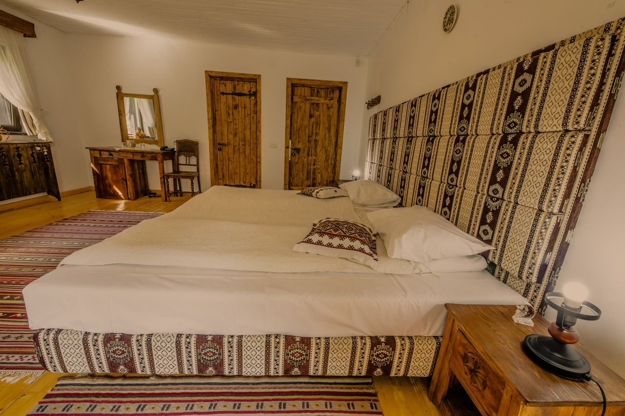 cabana izvoranu buzau camera 4 dormitor